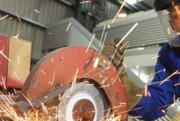 professional welder cutting metal